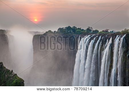 Victoria Falls sunset from Zambia side, red sun