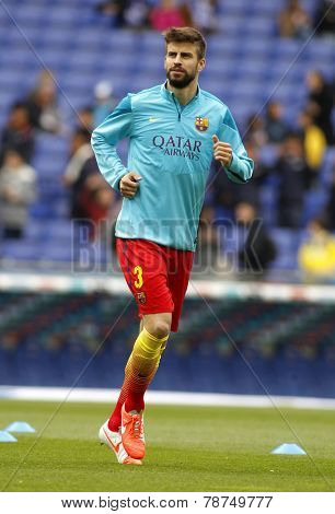 BARCELONA - MARCH, 29: Gerard Pique of FC Barcelona during the Spanish League match between Espanyol and FC Barcelona at the Estadi Cornella on March 29, 2014 in Barcelona, Spain