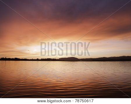 Red sunrise over Tauranga Harbor, New Zealand.