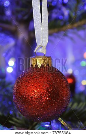 Red ball in christmas tree