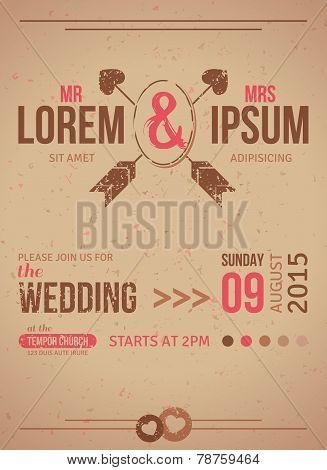 Vintage wedding invitation card with textured design elements.