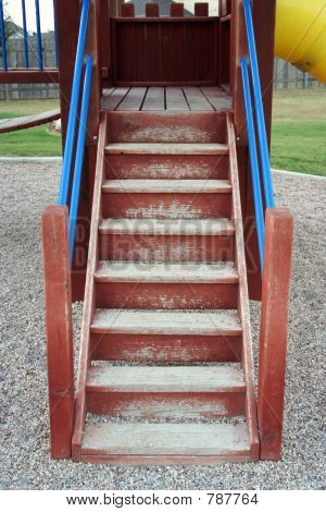 A set of stairs on a playscape at a playground. poster