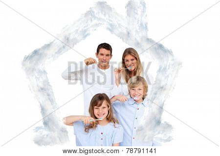 Smiling young family brushing their teeths against house outline in clouds