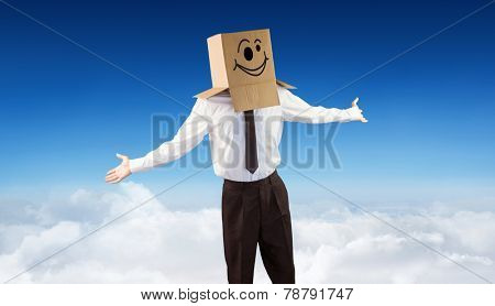 Anonymous businessman with arms out against blue sky over clouds
