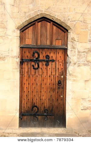 Wooden door outside Gloucester Cathedral