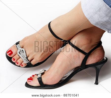 Female feet with fancy shoes sandals isolated on white poster