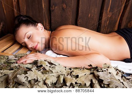 Beauty Relaxing In Bathhouse.