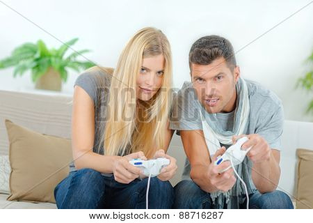 Competitive couple playing video games