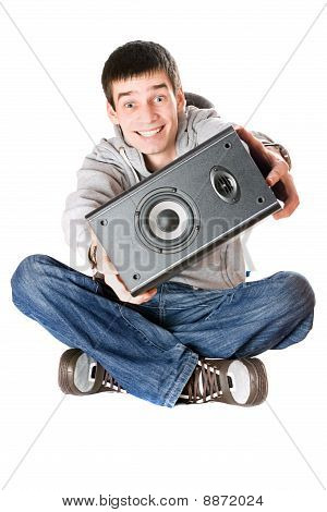Smiling Young Man With A Speaker