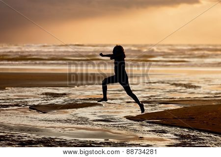 Girl leaps into the water.