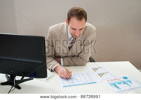 Businessman Making Gantt Diagram In Office