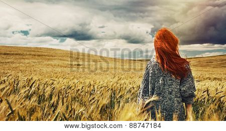 Young Traveller Standing Back On Plain Field And Breathtaking View Of Dramatic Storm Sky