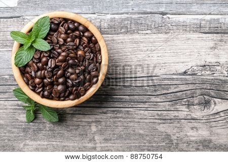 coffee beans with a wooden background
