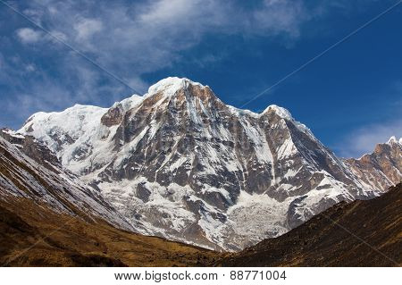 """Annapurna South peack in the Nepal Himalaya - view from Annapurna Base Camp. Annapurna is a Sanskrit name which literally means """"full of food"""" but is normally translated as Goddess of the Harvests. poster"""