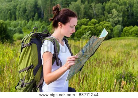 Female hiker reading map