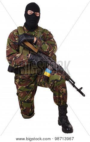 Ukrainian militiaman with kalashnikov rifle isolated on white poster