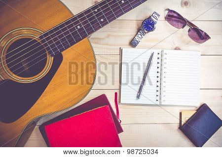 Red Book On Guitar For Writing Music , Concept Of Music
