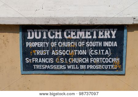 Dutch Cemetery Sign On The Wall In Fort Kochi