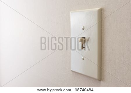 Classic light switch hanging on the wall