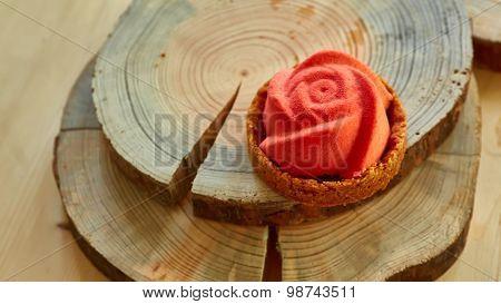 Home made tartlet rose on wooden background.