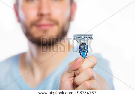 Young Man With Beard Showing Razor Blade
