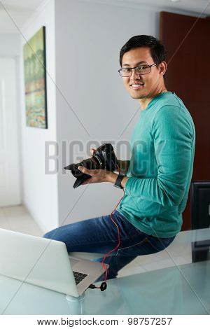 Asian Man Connect Dslr To Pc Download Pictures On Laptop