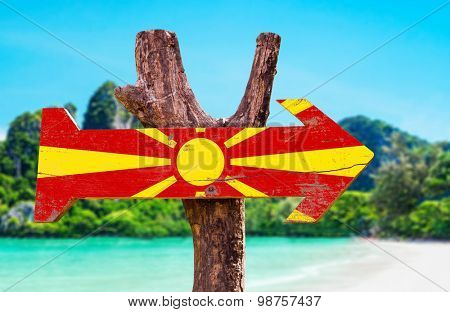 Macedonia Flag wooden sign with lake background