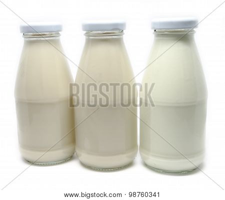 Bottles Of Soy And Dairy Milk Isolated