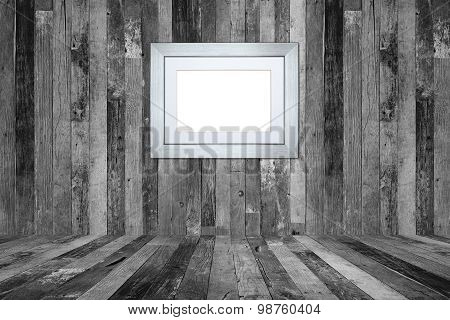 Picture Frame On The Old Wooden Wall