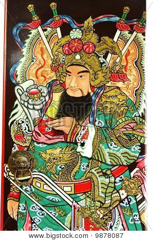 God guardian. Chinese painting on temple walls and doors