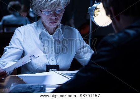 Policewoman Examining A Suspect