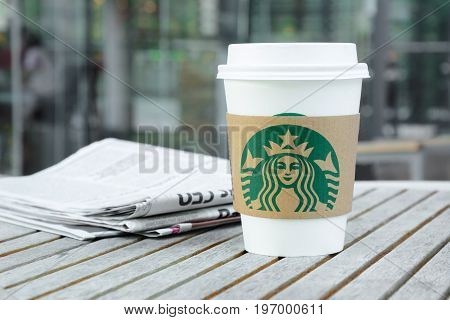 Bangkok Thailand - Feb 26 2015 : Starbucks coffee cup on the table in Starbucks coffee shop Starbucks brand is one of the most world famous coffeehouse chains from USA.