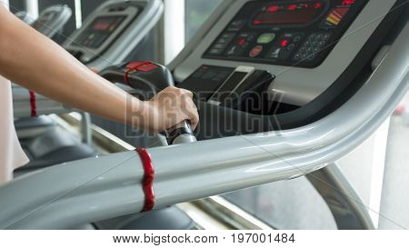 Woman Jogging And Running On Treadmill Cardio Machine