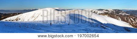 Wintry view from Velka Fatra mountains with tourist and mount Ostredok - Slovakia