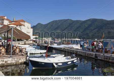 PERAST MONTENEGRO - JUNE 27 2017: On the pier of Perast. A small town of the Boka-Kotorska Bay constantly meets tourists