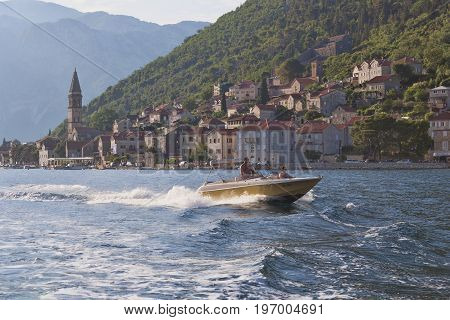 PERAST MONTENEGRO - JUNE 27 2017: Unknown man and woman travel by boat along the Boka-Kotor Gulf.