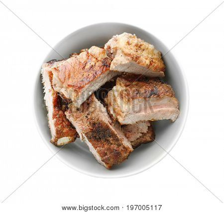 Juicy fried spare ribs in bowl, isolated on white, top view
