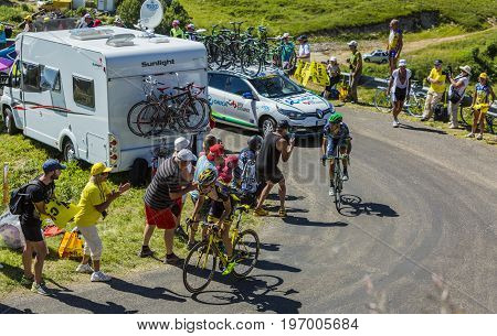 Col du Grand ColombierFrance - July 17 2016: Romain Sicard of Direct Energie Team and Ruben Plaza Molina of Orica-BikeExchange Team riding on the road to Col du Grand Colombier in Jura Mountains during the stage 15 of Tour de France 2016.
