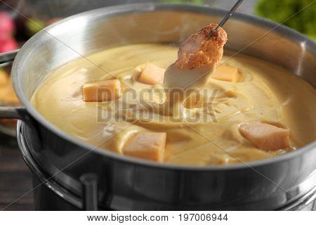 Rusk and cheese fondue, closeup
