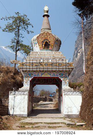 buddhist stupa in Chame village round annapurna circuit trekking trail Nepal