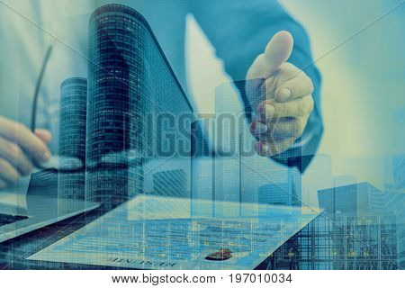 Concept of consulting. Double exposure of cityscape and hr manager with resume