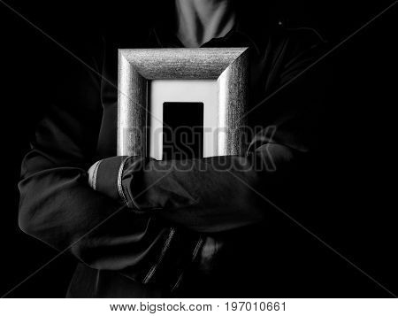 Female Hands Isolated On Black Hugging Photo Frame