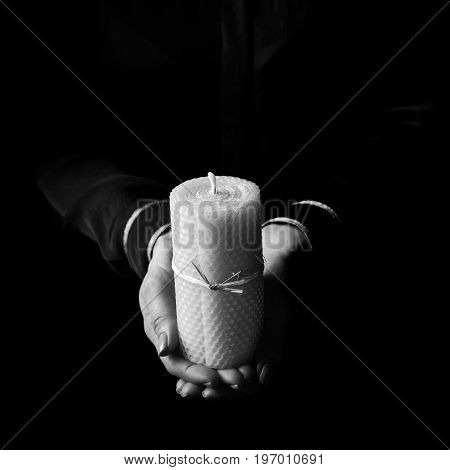Female Hands Isolated On Black Background Showing Candle