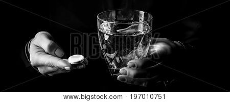 Female Hands Isolated On Black Showing Pill And Glass Of Water
