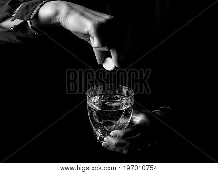 Female Hands Showing Effervescent Tablet And Glass Of Water