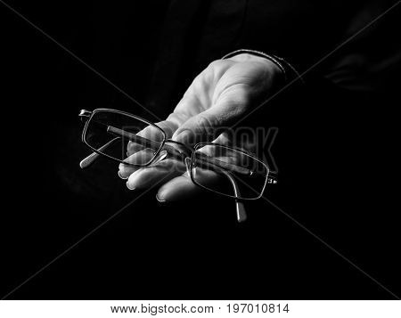 Female Hand Isolated On Black Showing Spectacles
