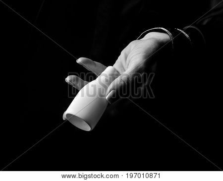 Woman Hand Isolated On Black Showing Bottle Of Medical Drops