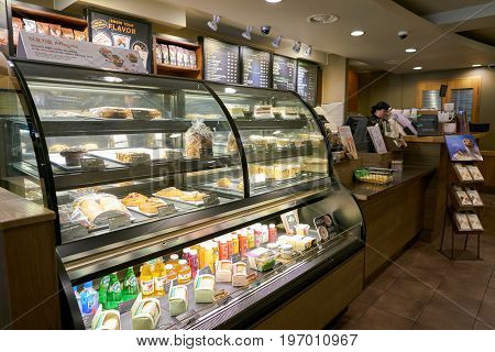 SEOUL, SOUTH KOREA -  CIRCA MAY, 2017: display case at Starbucks coffee shop in Seoul. Starbucks Corporation is an American coffee company and coffeehouse chain.