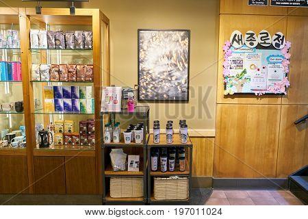SEOUL, SOUTH KOREA -  CIRCA MAY, 2017: inside Starbucks coffee shop in Seoul. Starbucks Corporation is an American coffee company and coffeehouse chain.
