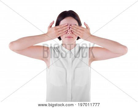 A tender and casual office woman isolated over the white background. A brunette young female closing her face with hands. Communication and misunderstanding problems concept.
